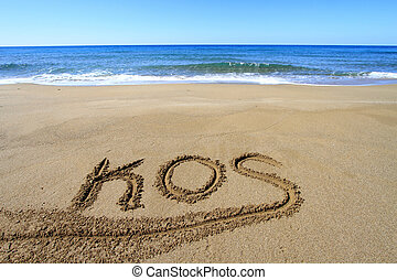 Kos written on sandy beach