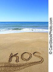 Kos written on sandy beach
