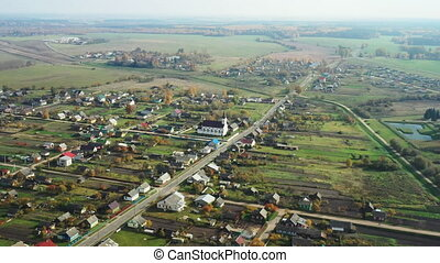 Kosava, Belarus. Aerial Bird's-eye View Of Kosava Village. Church of the Holy Trinity. Historic Landmark And Heritage In Sunny Autumn Day. Drone Flight.