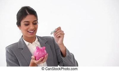 kostuum, geld, geklede, het putten, piggy-bank, vrouw