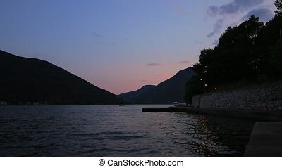 Kotor Bay in Montenegro night. Wharf in the city Perast -...