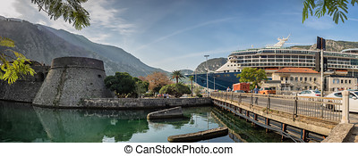 Kotor fortress lower part with cruiseship in Montenegro -...