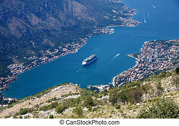 Kotor bay and fjord landscape with cruise ship