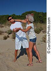 kpienie, plaża, kłótnia