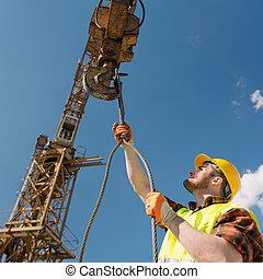 kraan, de arbeider van de bouw