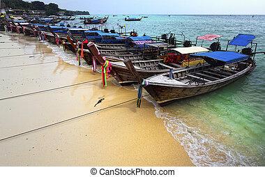 krabi phi phi island - long tail boat on krabi beach, phi...