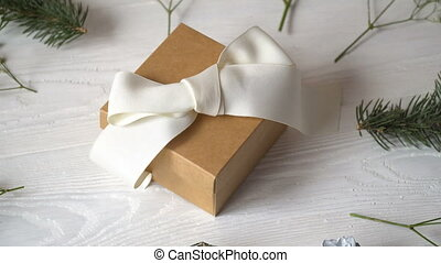 Kraft gift with white bow and flowers for greeting card for...