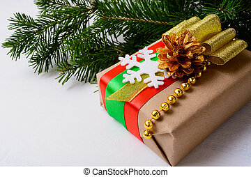 Kraft paper wrapping Christmas gift decorated with snowflake