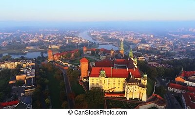 Krakow, Poland. Wawel royal Castle and Cathedral, Vistula River. Aerial 4K flyby video at sunrise in summer