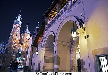 Krakow Sukiennice and St. Mary's Basilica on the Left - Cracow Main Square at Night. Krakow, Poland. Cities Photography Collection.