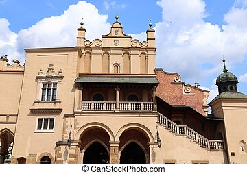 Krakow Old Town in Poland. Medieval Sukiennice (Cloth Hall) market at Rynek Glowny square (UNESCO World Heritage Site).