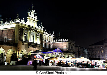 Krakow at night. Beautiful Polish city that once has been the capital city. The view of main market square.
