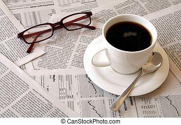 krant, koffie, op