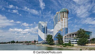 Krasnodar, Russia - July 03: Skyscraper and embankment along a river on July 03, 2016 in Krasnodar, Russia.