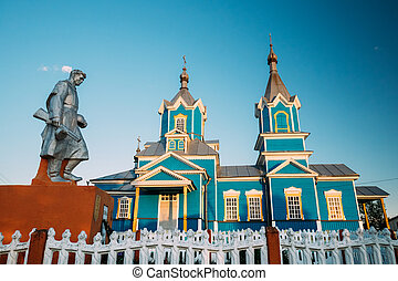 Krasnyy Partizan, Gomel Region, Belarus. Monument To Heroes Who Died In Battles For Liberation Of Gomel Region At Great Patriotic War, Old Orthodox Church Of Nativity Of Virgin Mary