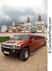 Kremlin in Izmailovo Moscow and red limousine with khokhloma pattern