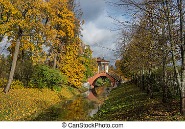 Krestovy bridge in autumn. Alexander Park of Pushkin,...