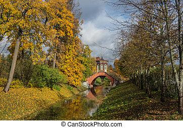 Krestovy bridge in autumn. Alexander Park of Pushkin,...