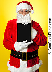 Kris Kringle presenting new updated tablet pc. Its for sale ...