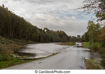 Kristiansand, Norway - October 3, 2017: Flooding from the river Tovdalselva, water in the road