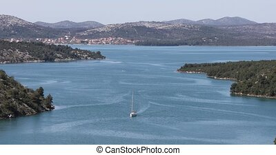 Krka canal aerial - Aerial view of the Yacht sailing through...