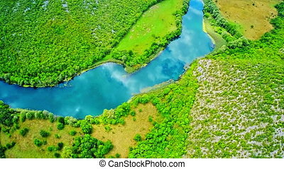 Krka river flow - National park - Copter aerial view of the...