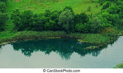 Krka riverside - Green Krka river scenery along the coast.