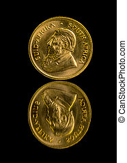 Krugerrand gold coin and reflection