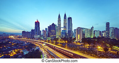 Kuala Lumpur city skyline at twilight, Malaysia .