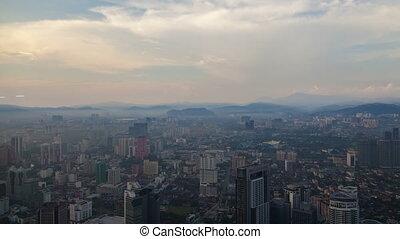Kuala Lumpur city skyline time-lapse. pan up