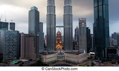 Kuala Lumpur City Center with rain Time-lapse at day to night. pan up