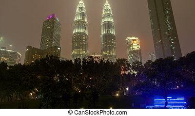 Kuala Lumpur City Center time-lapse at rain. pan up