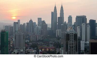 Kuala Lumpur sunrise cityscape time-lapse. pan up