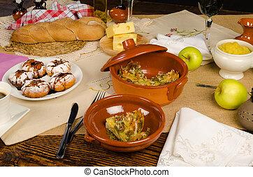 Kugel - Homemade kugel served on a festive Hanukkah table