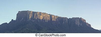 Kukenan tepui or Mount Roraima with blue sky in the morning. Venezuela