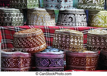 The Kumma, is the typical Omani cap. Colorful and precious, it is used during unofficial times