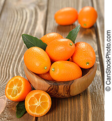 kumquat on brown background closeup