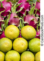 Kumquats and dragon fruits on the market