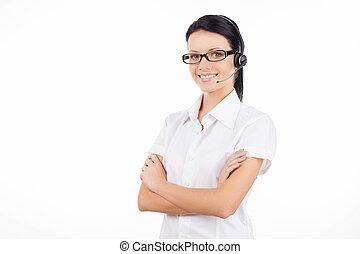 kund, hörlurar med mikrofon, hålla, kvinna, henne, service, ung, isolerat, stående, representative., tillitsfull, medan, korsat beväpnar, le, vit
