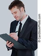 kupiec pisanie, na, clipboard, nosić, elegancki, garnitur, i, tie.
