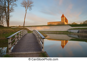 Kuressaare castle and bridge over the moat in beautiful sunrise light