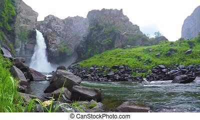 Kurkure waterfall. Slow motion. Altai Mountains Siberia...