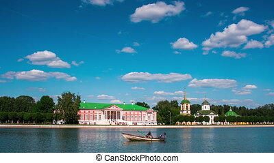 Kuskovo palace and pond with boats in the sunny summer day, timelapse