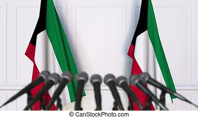 Kuwaiti official press conference with flags of Kuwait. 3D...