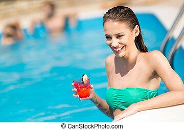 kvinde afslappende, sol garve, pulje, svømning