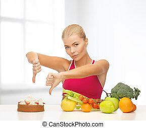 kvinde, hos, frugter, viser, tommelfingre derned, til, kage