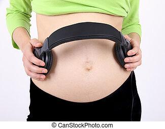 kvinde, underliv, hovedtelefoner, gravide