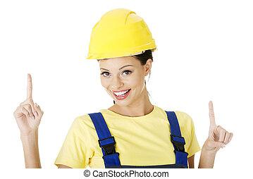 kvindelig, konstruktion arbejder, pege, på, kopi space