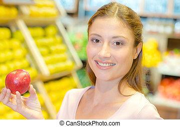 kvinna, äpple, holdingen