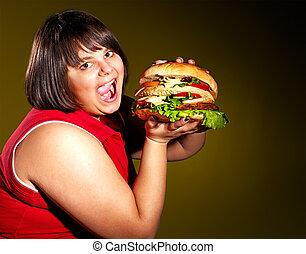 kvinna ätande, hamburger.